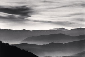 Black and white image of distant mountains with fog