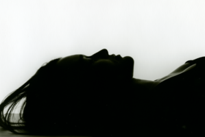 Silhouette of woman's head lying down from the side