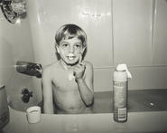Text on photograph reads: Shaving like dad.